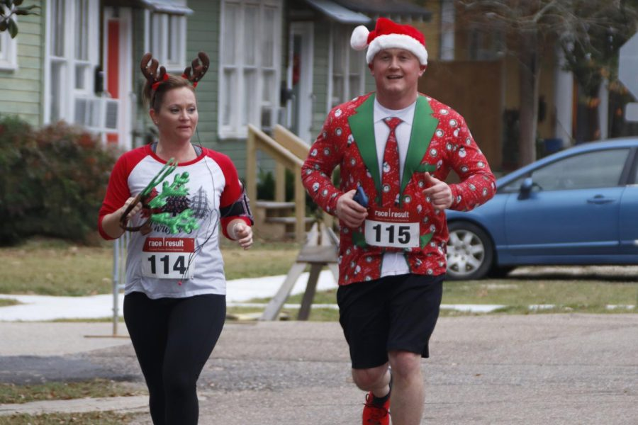Runners+in+holiday+apparel+participate+in+the+annual+Reindeer+Run+5K+Race+in+downtown+Hammond.+The+annual+marathon+was+held+on+Dec.+7+in+Cate+Square+Park.+