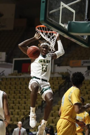 Junior forward Pape Diop, native of Ziguinchor, Senegal, dunks the ball in the 79-74 victory over Southern University at New Orleans