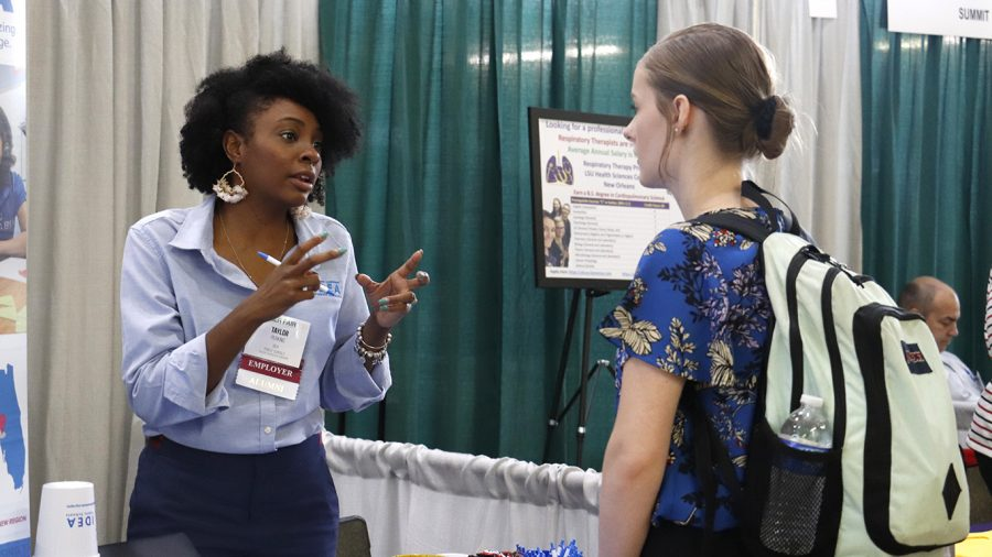 A student talks with a potential employer at the 2019 Career Fair. The Big Interview Program gives students and alumni  the opportunity to practice job interviews online. File Photo/The Lion's Roar