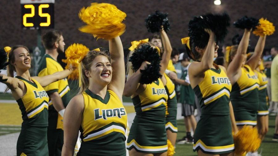 Junior Kristine Stubbs cheers on the Lions in a 2019 football game. Cheer clinics will be hosted on March 22 also on April 5 and 22.