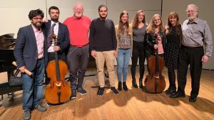 Harrell poses with university students after a masterclass in Daniel Cassin's studio.