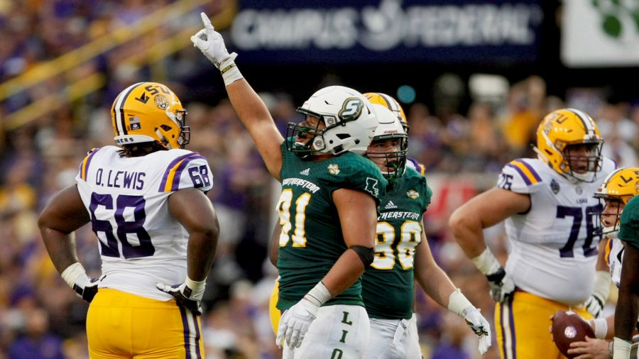 Isaac+Adeyemi-Berglund+celebrates+a+sack+in+the+2018+matchup+against+Louisiana+State+University.+The+Lions+lost+to+the+Tigers+31-0+to+fall+to+0-2.+