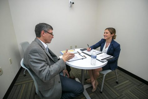 Sales professional Jeff Brown and senior marketing major Ashley Murphy participate in  the Spring 2020 Sales Competition in one of the role-play rooms that have recording technology. The Professional Sales Lab allows students and professors to review footage from the role-play rooms and give feedback.