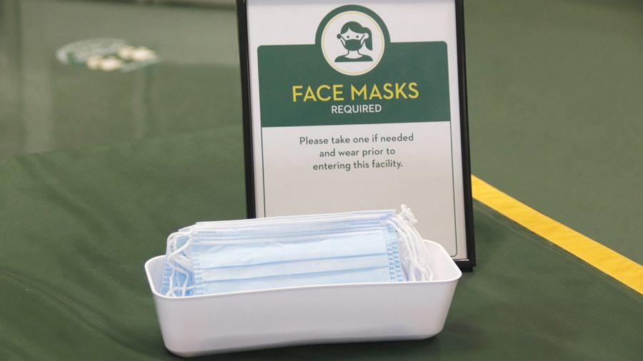 Face masks are distributed in building entrances for students and faculty in case they do not have one. Individuals must wear a mask when inside a building, according to new guidelines set by the university.