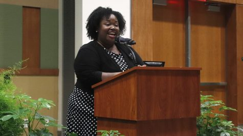 OSE director Marjorie Parker speaks to the audience during the 2019 DSA Convocation ceremony.