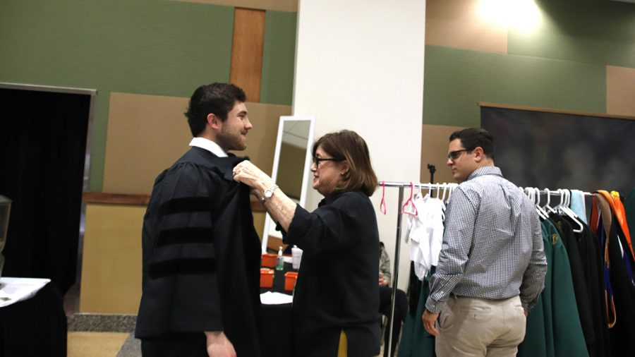 Graduating students get ready to take pictures at the Grad Fair last year at the Student Union Ballroom. This year, the event will be held in the Pennington Center.
