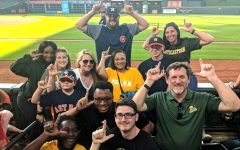 Members of the sport management  program pose for a picture while on a field trip a Houston Astros baseball game.