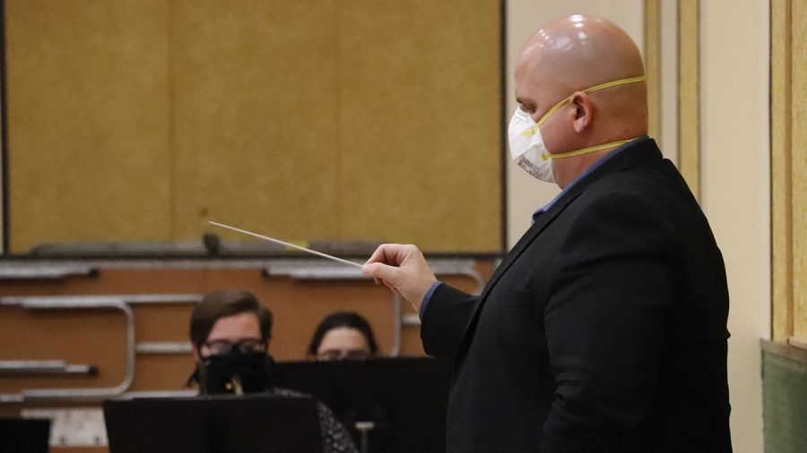Wind Symphony director Victor Drescher leads a socially-distanced rehearsal. Drescher came to the university in 2013 and serves as an instructor of clarinet in addition to directing the Wind Symphony.