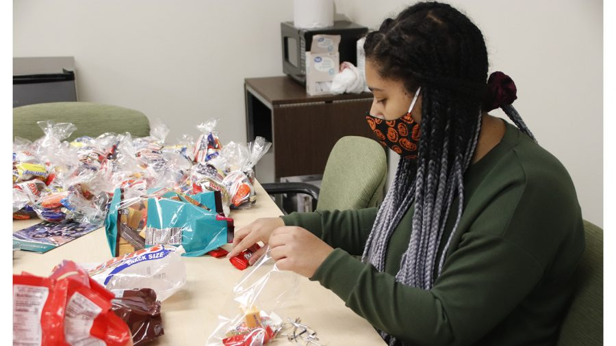 Student worker Frannie Reyes, junior psychology and criminal justice major, prepares goodie bags in the Office of Military & Veteran Success. The office will have a table set up near the Student Union on Wednesday, Nov. 11 from 11 a.m.-3:30 p.m. to commemorate Veterans Day and hand out the goodie bags.