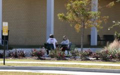 Two students study outside of Garrett Hall. Finals week will commence from Monday November 30 to Thursday December 3. Several departments have modified their hours in light of finals week.