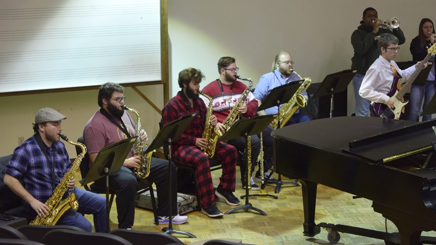 """Some members of the jazz ensemble dressed up in Christmas apparel for rehearsal. The concert will be livestreamed from KSLU's Facebook page and will feature Christmas songs such as """"Christmas Time is Here,"""" """"Deck the Halls,"""" """"It Came Upon a Midnight Clear"""" and """"Jingle Bells."""""""