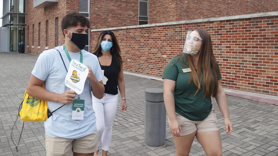 Orientation leader Claire Krousel gives private tour on campus to prospective student during the Destination Southeastern event. Due to social limitations from the pandemic, the university restructured Lion Pride Preview and currently includes events such as Destination Southeastern and private tours.