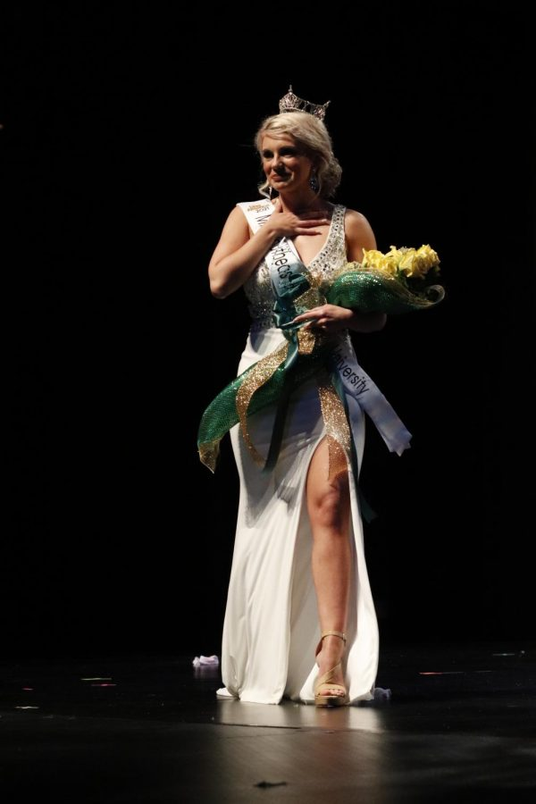 Moments after being crowned, Lily Gayle takes her first walk as Miss Southeastern Louisiana University 2021.
