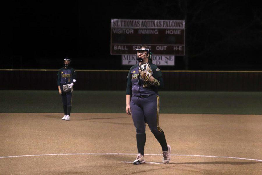Zumo stands at the pitchers mound at the Lion Classic season opener on Thursday, Feb. 11.