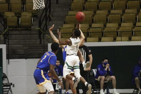 Senior guard Keon Clergeot pushes through the Cowboys' defense and goes for a shot during the last home game of the 2021 season against McNeese State University on Feb. 24.