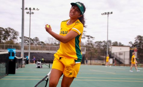 In the home opener on Feb. 21, sophomore tennis player Putri Insani, above, earned a 6-0 win in the doubles round with junior Ximena Yanez and a 6-3, 6-0 win in the singles round.