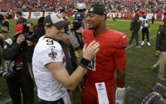 In this Dec. 9, 2018, file photo, New Orleans Saints quarterback Drew Brees (9) shakes hands with Tampa Bay Buccaneers quarterback Jameis Winston (3) after an NFL football game in Tampa, Fla. Winston signed a one-year contract with the Saints in 2021.