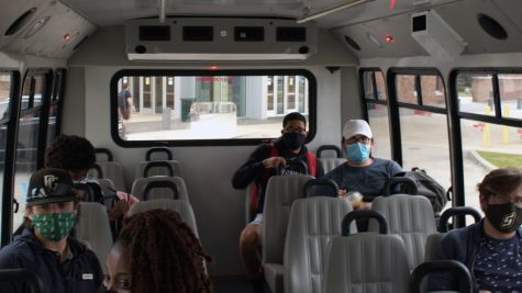 Students sit socially distanced on the Lion Traxx shuttle bus as they head to their next destination. In order to use university transportation, students are required to follow all safety protocols and regulations.