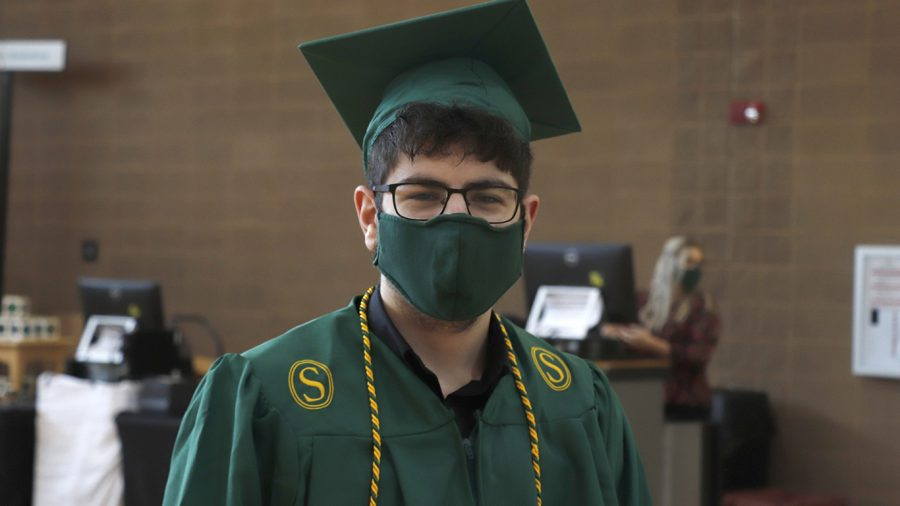 Graduating senior smiles behind his mask at Grad Fair in October 2020. For the Fall 2020 semester, the Alumni Association held Grad Fair in the Pennington Student Activity Center.