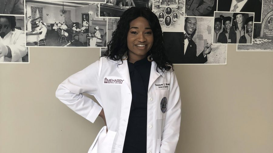 Treasure Brown poses at her white coat ceremony at Meharry Medical College. For Trinity, her bond with her sister has uplifted and inspired her.