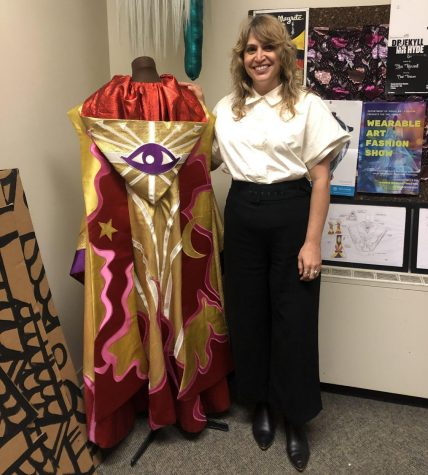 Christine Crook, assistant professor of costume design and make-up technology, shows off a costume she made in back 2019.
