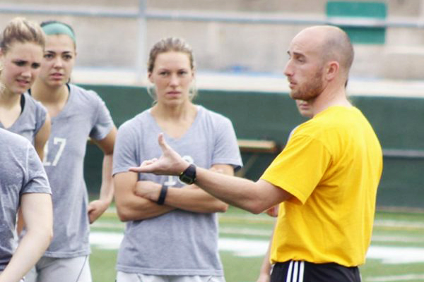 Christopher McBride, pictured on the right, interacting with his players during practice, in his first season at Southeastern. The Lady Lions won the Southland Conference Tournament this year prompting McBride receiving the Coach of the Year award. Southeastern will take on Rutgers on April 27.