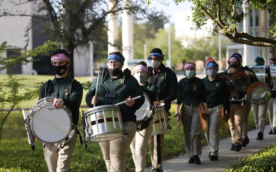 Band members perform on their way to Strawberry Stadium as the Lions football team faces off against Northwestern State.