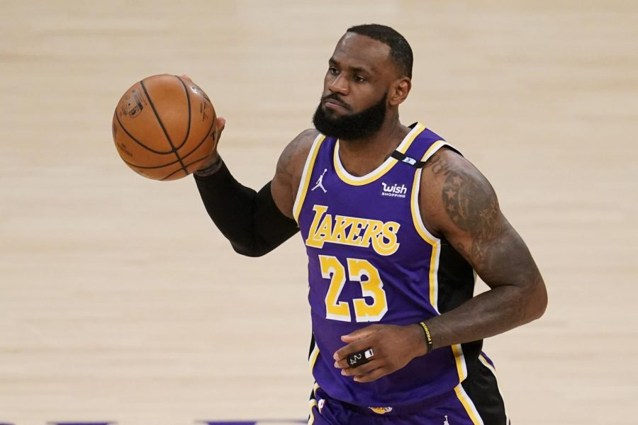 Los Angeles Lakers' LeBron James dribbles the ball during the first half of the team's NBA basketball game against the Sacramento Kings on Friday, April 30, 2021, in Los Angeles. (AP Photo/Marcio Jose Sanchez)