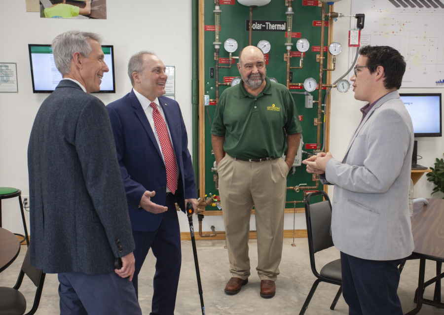 (From right to left) Sustainability manager Alejandro Martinez introduces Physical Plant Director Bryon Patterson, U.S. Rep. Steve Scalise and University President John L. Crain to the Sustainability Center. The SEED Building is an educational experience where they learn about geothermal heating, solar power and more.