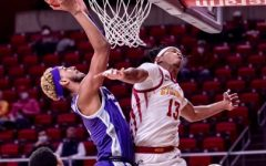 As a Kansas State Wildcat, center Antonio Gordon goes for a shot against the Iowa State Cyclones. A native of Lawton, Okla., Gordon signed on for Southeastern's men's basketball team for next season.