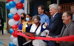 U.S. Sen. Bill Cassidy cuts the ceremonial ribbon alongside administrators of the Regina Coeli Child Development Center and other contributors of the new building.