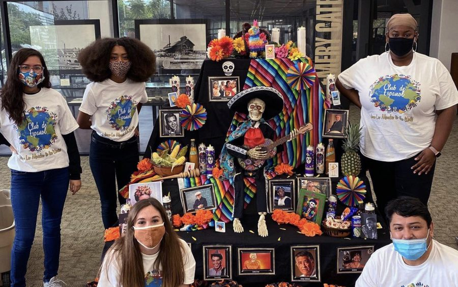In honor of Day of the Dead, The Spanish Club stands by their handmade cultural display outside of the Sims Memorial Library in November of 2020.