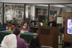 Dr. Elizabeth Hornsby, Dr. Carol Madere and Dr. Sam Cavell participate in a panel hosted by the Sims Memorial Library marking the opening of the