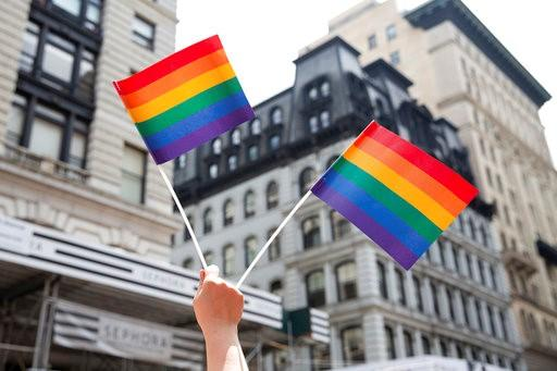 An attendee holds up flags during the New York City Pride Parade, Sunday, June 24, 2018, in New York. (AP Photo/Steve Luciano)
