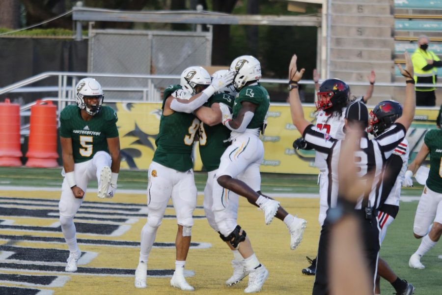 The Lions celebrate after scoring a touchdown in the April 3 football game versus Lamar University at Strawberry Stadium. Student-athletes around the country can now earn money for their name, image and likeness according to the recent NIL ruling from the NCAA.