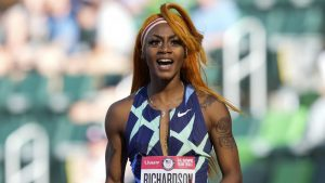 """In this June 19, 2021 photo, Sha'Carri Richardson celebrates after winning the first heat of the semi finals in women's 100-meter run at the U.S. Olympic Track and Field Trials in Eugene, Ore.    Richardson cannot run in the Olympic 100-meter race after testing positive for a chemical found in marijuana.  Richardson, who won the 100 at Olympic trials in 10.86 seconds on June 19, told of her ban Friday, July 2 on the """"Today Show.""""(AP Photo/Ashley Landis)"""