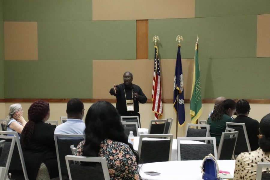 Dr. John Hatcher speaks to audience members during the open discussion part of the summit. The AAME summit occurred on Friday, July 23 and Saturday July 24.