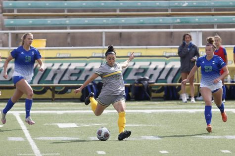 Midfielder Mya Guillory goes to kick the ball to another teammate in the April 3 game against Texas A&M Corpus Christi last season. The Lady Lions defeated the Islanders 3-1.