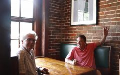 Paul Murphy (left) and Rick Colucci sit in a booth at Bradys Restaurant on SW Railroad Avenue in Downtown. They co-own three restaurants: Jacmel Inn and Bradys in Hammond and Nuvolaris in Mandeville. The two have been business partners for over 40 years and have had an even longer friendship.