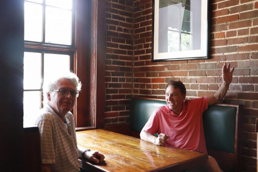 Paul Murphy (left) and Rick Colucci sit in a booth at Brady's Restaurant on SW Railroad Avenue in Downtown. They co-own three restaurants: Jacmel Inn and Brady's in Hammond and Nuvolari's in Mandeville. The two have been business partners for over 40 years and have had an even longer friendship.