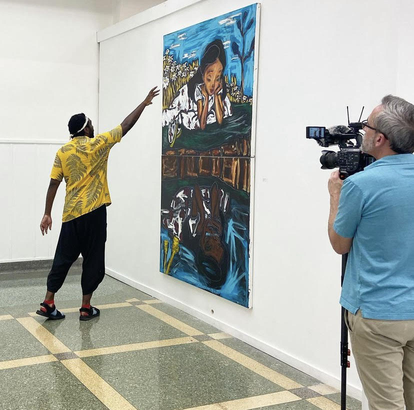 John Isiah Walton at the SLU Contemporary Art Gallery giving a tour of the exhibit as well as explaining the details of some of his pieces. Walton's work will be in the SLU gallery until September 2.