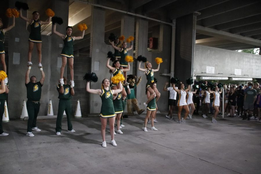 The Lionettes and cheerleaders hype up the crowd at Strawberry Jam in the parking garage. Strawberry Jam was moved from the field to the parking garage at Strawberry Stadium due to weather.