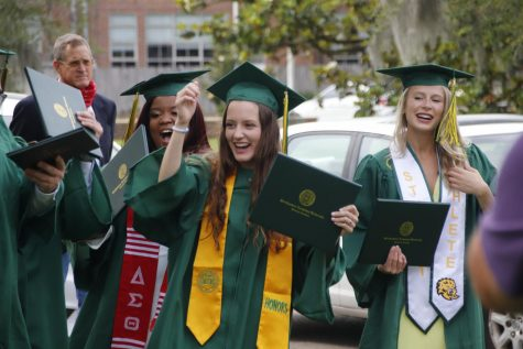 Recent alumni celebrate their achievements after the Spring 2021 Nursing and Health Sciences commencement ceremony on May 19. The deadline to submit Fall 2021 graduation applications is Wednesday, Sept. 22.