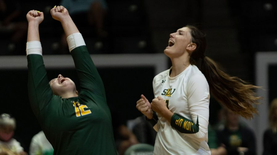 Sophomore+defensive+specialist+Calli+Collins+%28left%29+and+junior+outside+hitter+Jolie+Hidalgo+celebrate+during+the+Sept.+21+match+against+Southern+Miss.+The+Lady+Lions+defeated+the+Lady+Eagles+3-2+in+their+first+victory+of+the+season.+