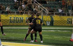 Maycie Massingill celebrates with Shamoy Campbell after scoring the first goal of her collegiate career.
