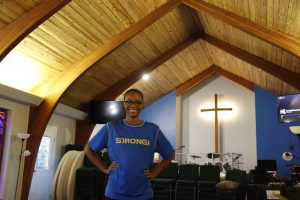 Junior music major Taleya Jordan stands inside the Southeastern Wesley Foundations Methodist Church, the location for the weekly Queer Communion meetings. Jordan created the group as a safe space for queer Christians to come together for bible study every Wednesday at 6:30 p.m.