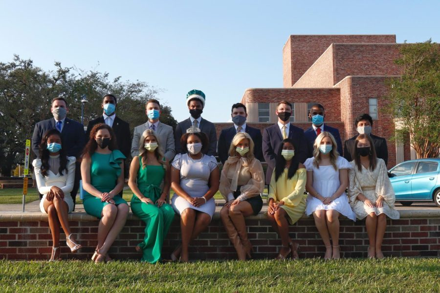 Members+of+the+2021+Homecoming+Court+sit+with+the+2020+Homecoming+king+and+queen+%28fourth+from+the+left%29%2C+Darnell+Butler+Jr.+and+Destiny+Richardson.