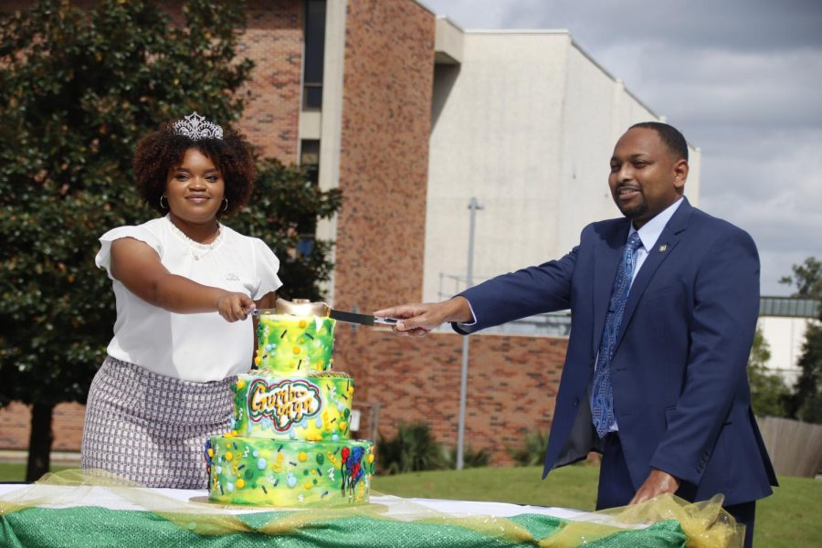 2020 Homecoming Queen Destiny Richardson and Vice President of Student Affairs Eric Summers cut the cake at Gumbo Ya Ya on Oct. 13. The 2021 Homecoming Court was introduced at the event.