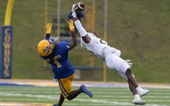 Sophomore defensive back Justin Douglas catches a pass during the Oct. 2 game against the McNeese State University Cowboys in Lake Charles. The Lions finished the game with 38-35 victory.