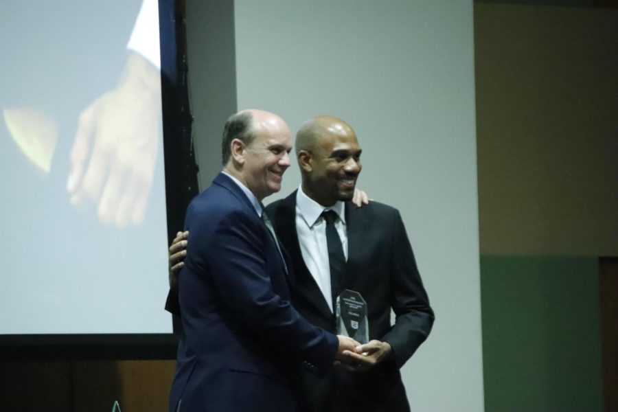Jonte Lee (right), a 2003 graduate, is recognized as the Distinguished Alumnus for the College of Science and Technology at the Alumni Awards Evening on Oct. 15 in the Student Union Ballroom.